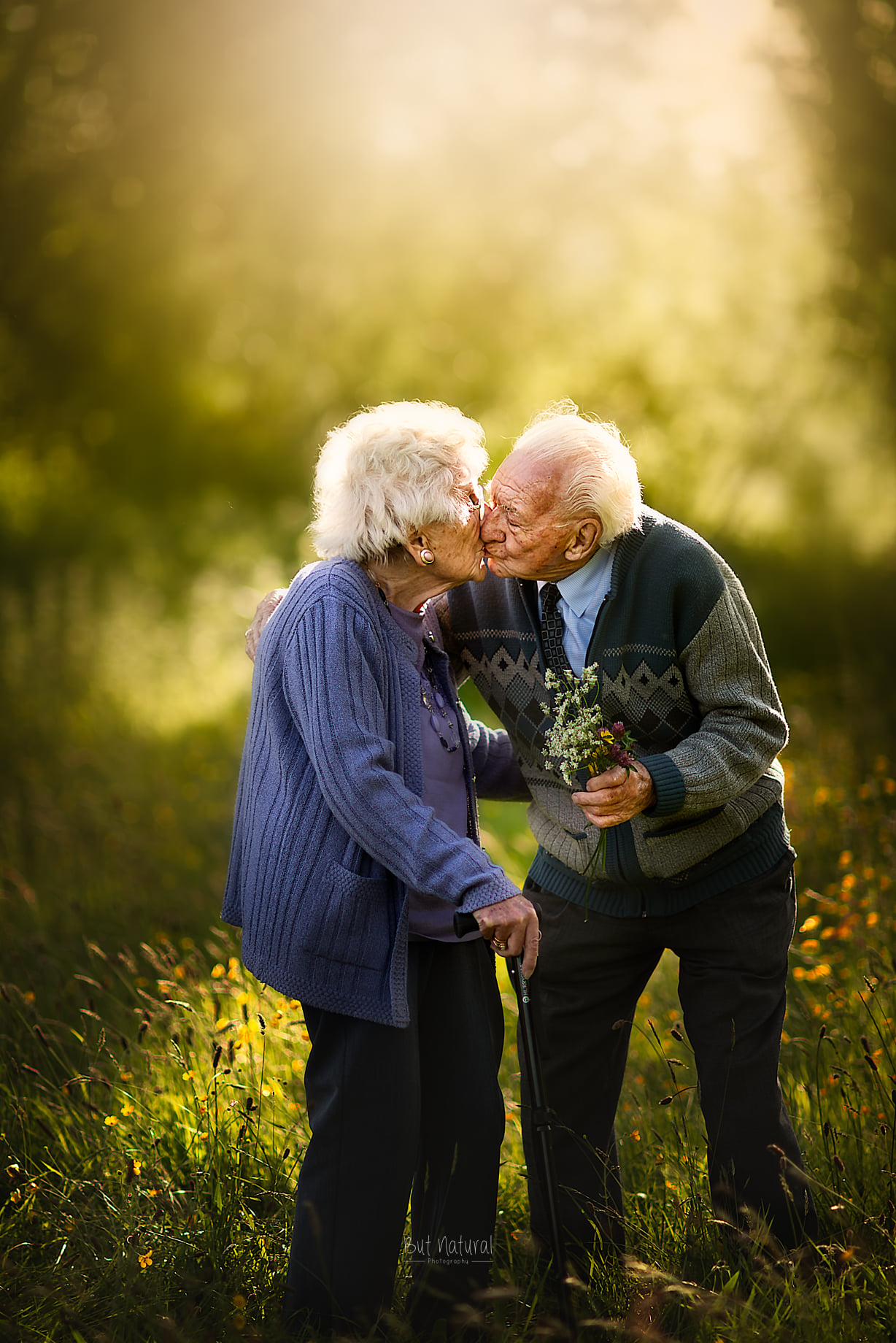 Elder couple kissing each other with love | But Natural Photography