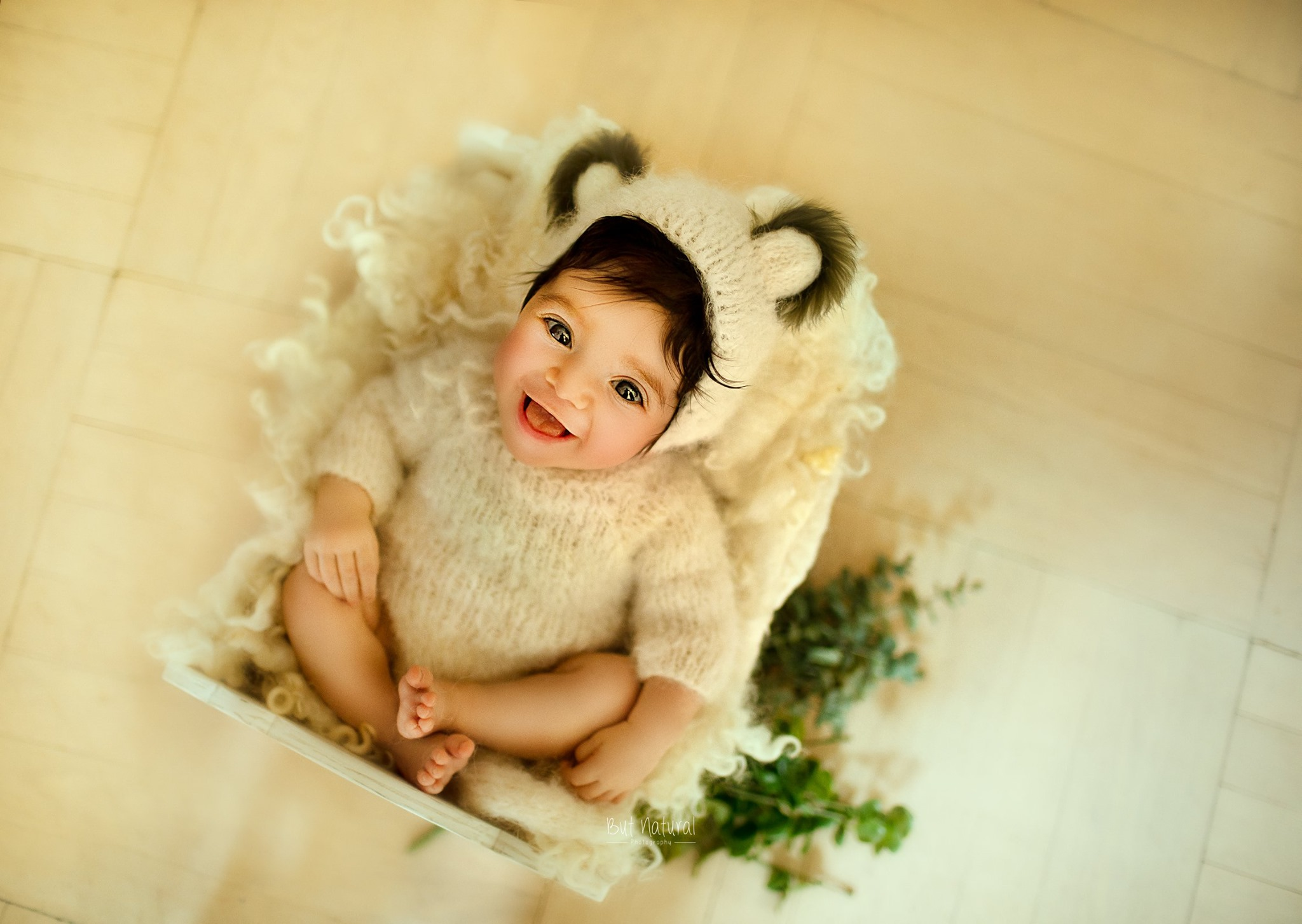 Newborn with a cute little smile in her face   But Natural Photography - Sujata Setia