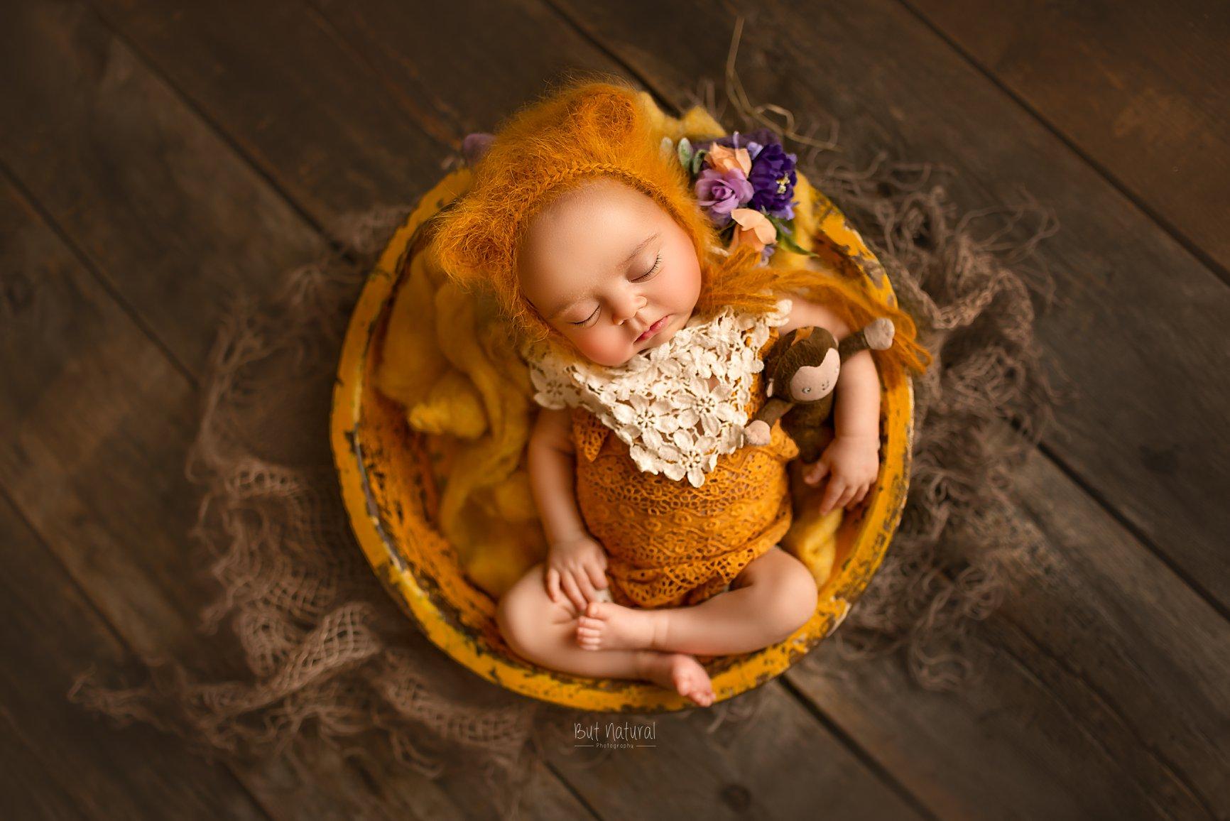 Newborn baby sleeping round-shaped prop for newborn photography session | But Natural Photography, Sujata Setia