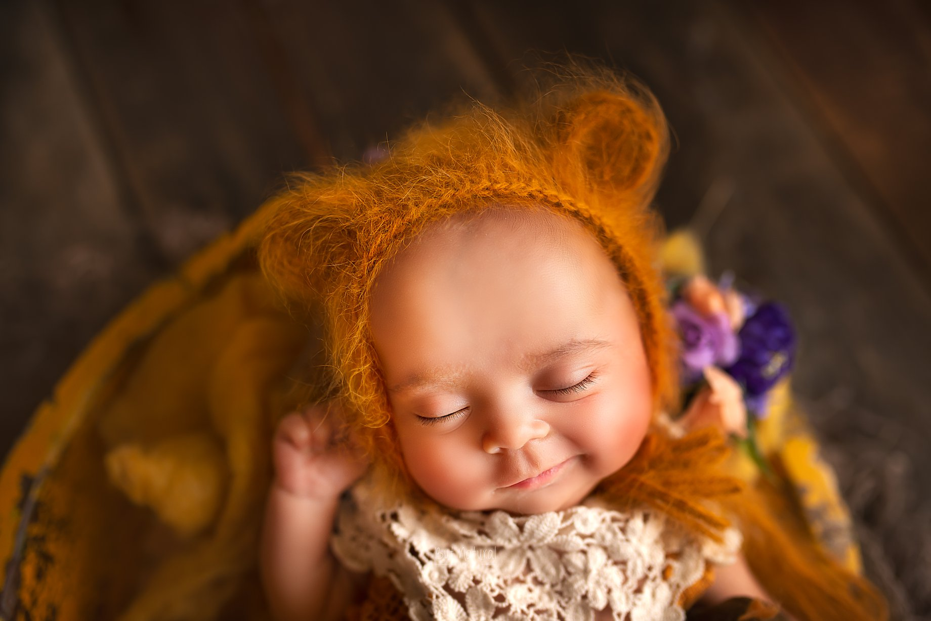 Newborn with a cute a cute little smile | Newborn baby photographer Sujata Setia | But Natural Photography