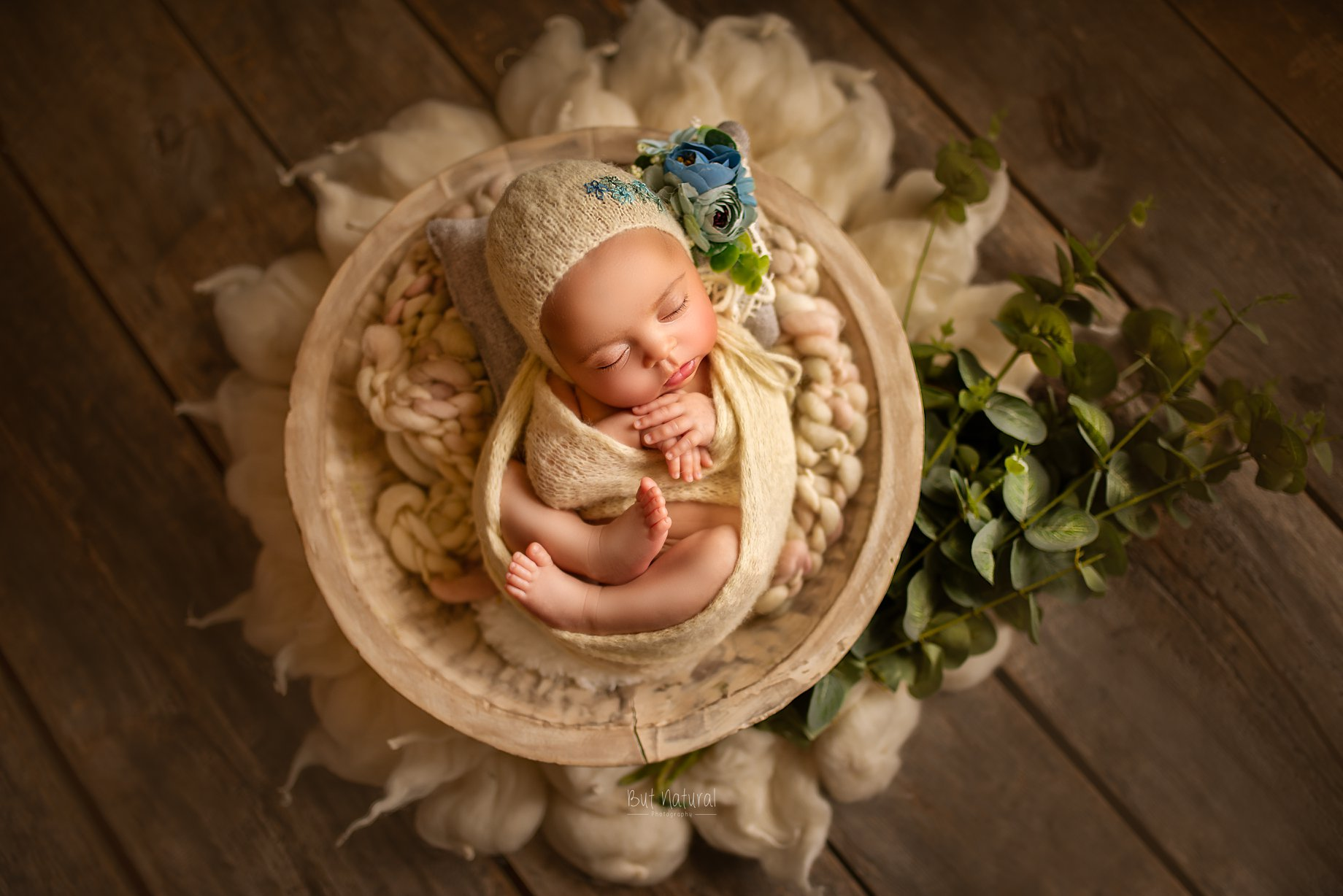 Newborn baby sleeping on a round-shaped prop | But Natural Photography, Sujata Setia