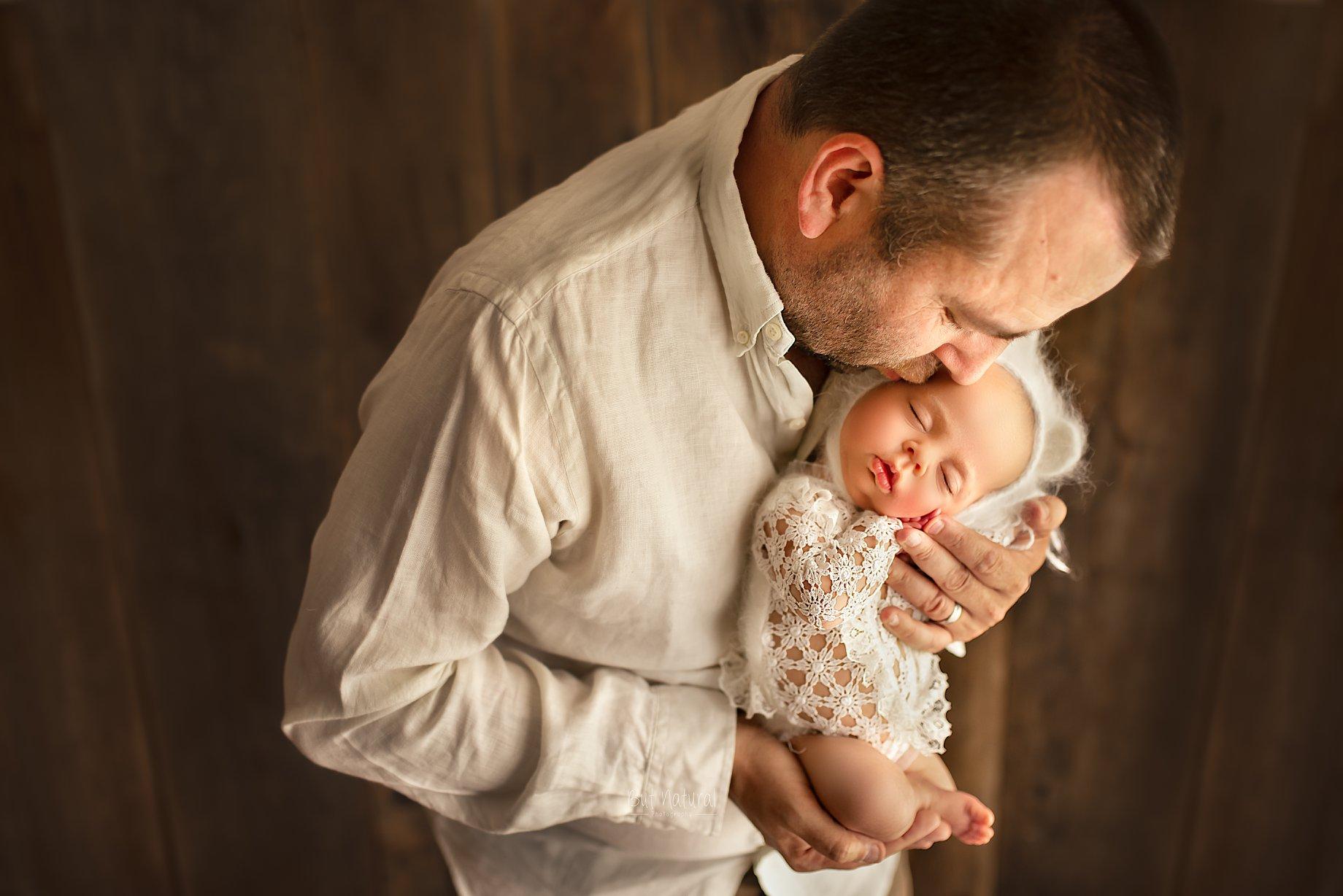 Dad with his newborn baby | Sujata Setia - Newborn photographer | But Natural Photography