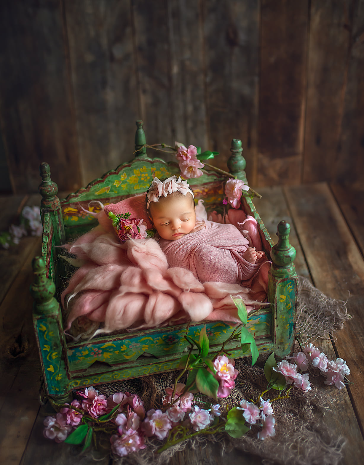 Cute little newborn sleeping on a prop for a newborn photoshoot by Sujata Setia   But Natural Photography