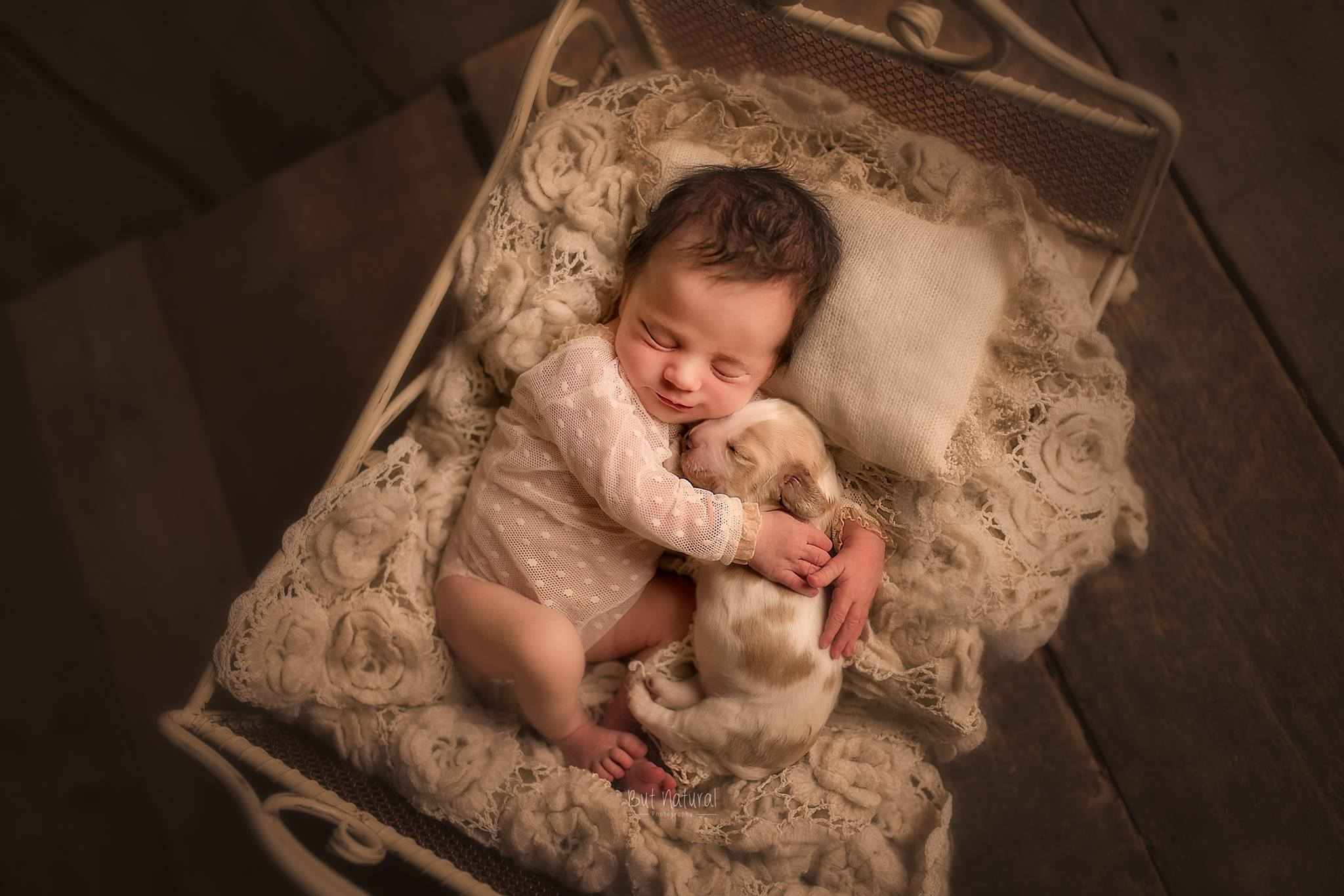 Newborn baby photoshoot with prop - But Natural Photography