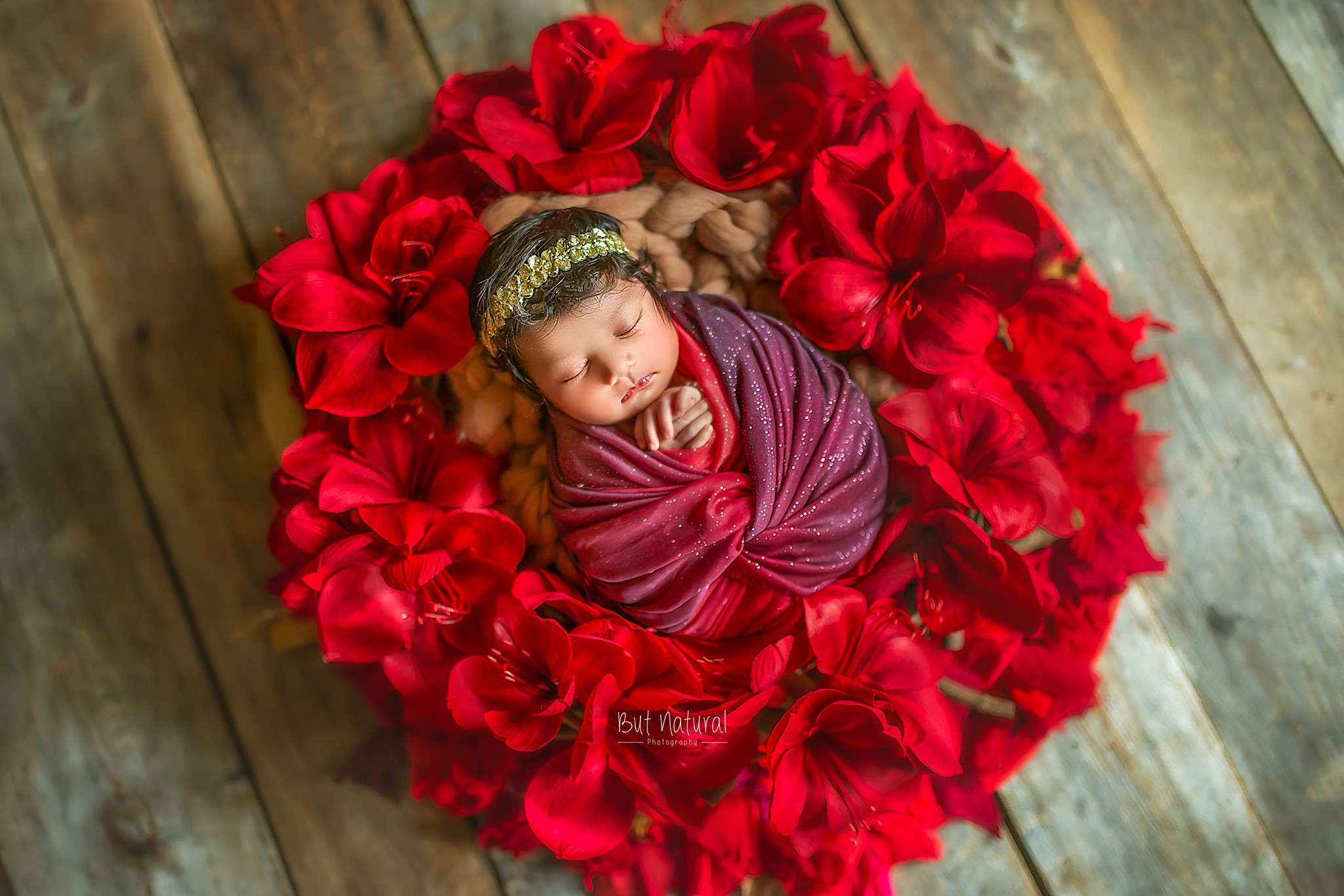 Newborn with flower prop for Newborn baby photoshoot | But Natural Photography