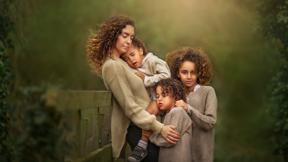 Mom standing with her three children's for a family photoshoot by Sujata Setia | But Natural Photography